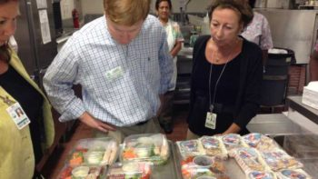 Florida Ag Commissioner Adam Putnam checks out prepared school lunches. School meals are looking more colorful these days as fresh produce finds a place on the tray.