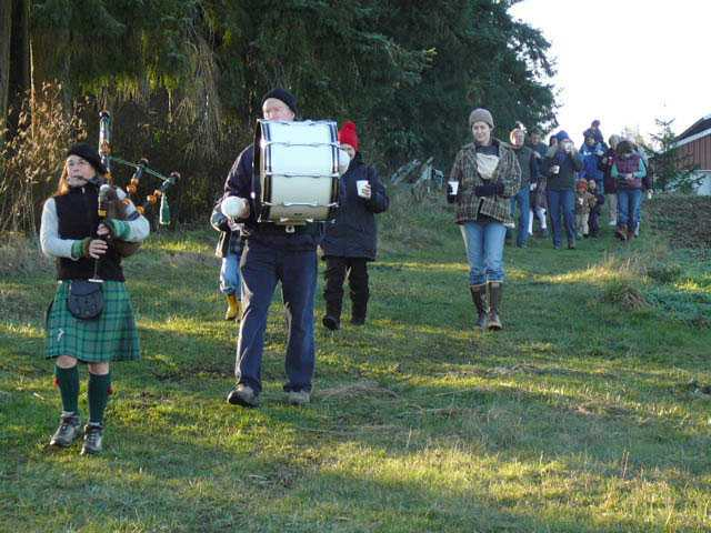 Bagpipes and drum lead wassail-goers into the orchard to bless the trees at Finnriver Farm & Cidery in Chimacum. WA. (Finnriver Farm & Cidery photo)