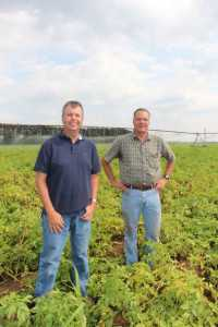 Sustainability is a key component at Okray Family Farms in Wisconsin. Pictured here (from left) Jim Okray, vice president of operations, and Rich Rashke, farm manager.