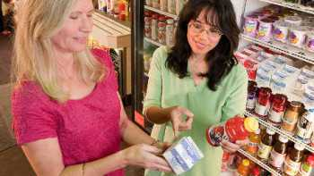 shoppers looking at food label