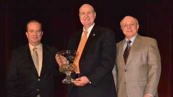 2014 Florida Grower Citrus Achievement Award winner Mike Sparks receives his trophy on stage from Florida Grower editor Frank Giles [left] and Keith Griffith, Chemtura AgroSolutions [right]. Photo by Paul Rusnak