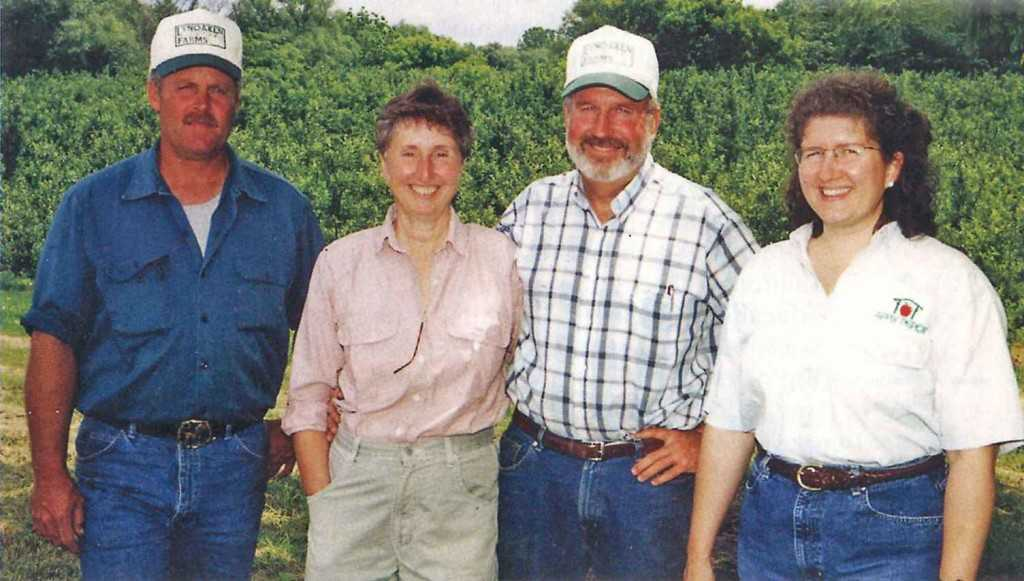 Darrel Oakes (third from left), American and Western Fruit Grower's 2004 Apple Grower of the Year, is a co-owner at LynOaken Farms in Lyndonville, NY, along with, from left, his cousin Jeff Oakes, Darrel's wife Linda, and his sister Wendy Wilson. (Photo Credit: Joe Ogrodnick)