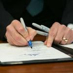 FL Gov. Rick Scott signs a bill
