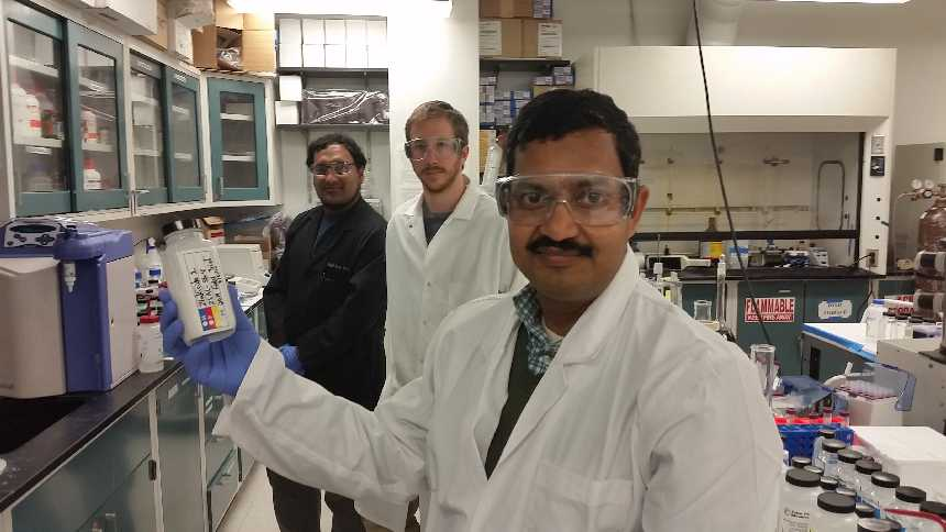Associate professor Dr. Swadeshmukul Santra holds a sample of Zinkicide in his UCF nanotechnology lab. Photo courtesy of UCF