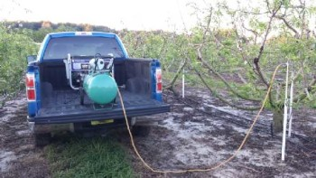 Water pump collecting leachate in Florida peach orchard