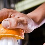 squeezing an orange