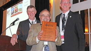 Harold Thome (center) was named to the IFTA Hall of Fame, with presentations from former IFTA President Phil Schwallier (left) and current IFTA President Tim Welsh (right).