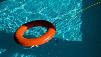 An orange life preserver with lifeline