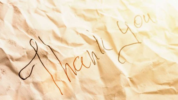 A tattered and wrinkled thank you note
