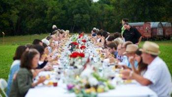 An open air farm dinner at Tangletown's farm FEATURE