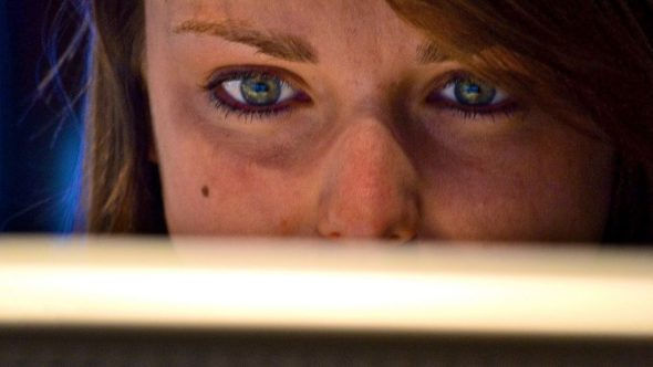 woman looking at a computer screen FEATURE