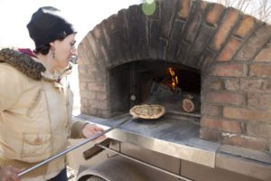 Brick oven pizza at Four Seasons Winter Farmers Market
