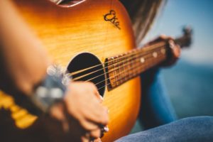 Live music woman playing guitar free image