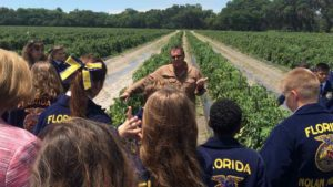 Gary Reeder of West Coast Tomato/McClure Family Farms in Florida takes learning full circle as he speaks to a young FFA audience on an ag tour. Photo credit: Manatee County Farm Bureau , Dan Wes