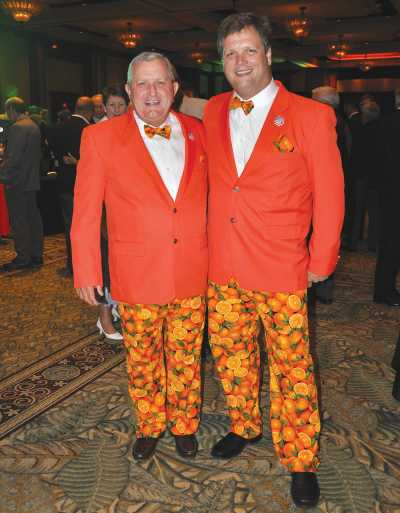Marty McKenna and Mark Wheeler show off thier orange suits at the Florida Citrus Industry Annual Conference
