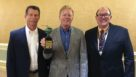 Apple Grower of the Year Scott McDougall shows off the award he received at the USApple conference. He is flanked by (left) sponsor Valent U.S.A.'s Rick Kraus, Vice President, Sales, and (right) David Eddy, Editor of American Fruit Grower magazine. (Photo credit: Richard Jones)