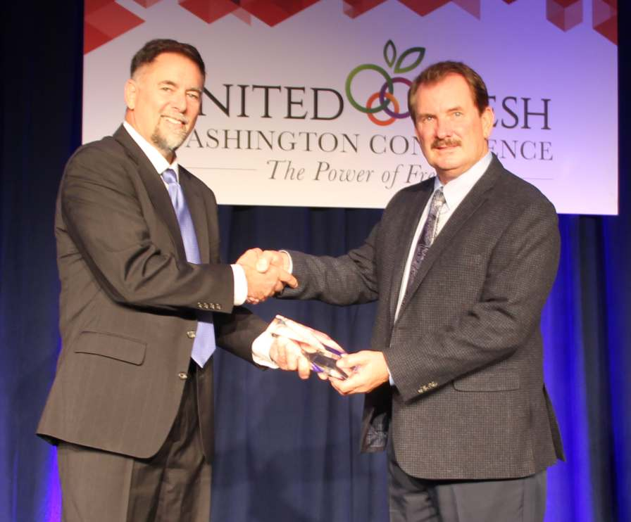 Lonny Smith of AgroLiquid, the sponsor of American Vegetable Grower's annual Grower Achievement Award helped present the 2016 award to Bob Bender of Tasteful Selections in Arvin, CA.