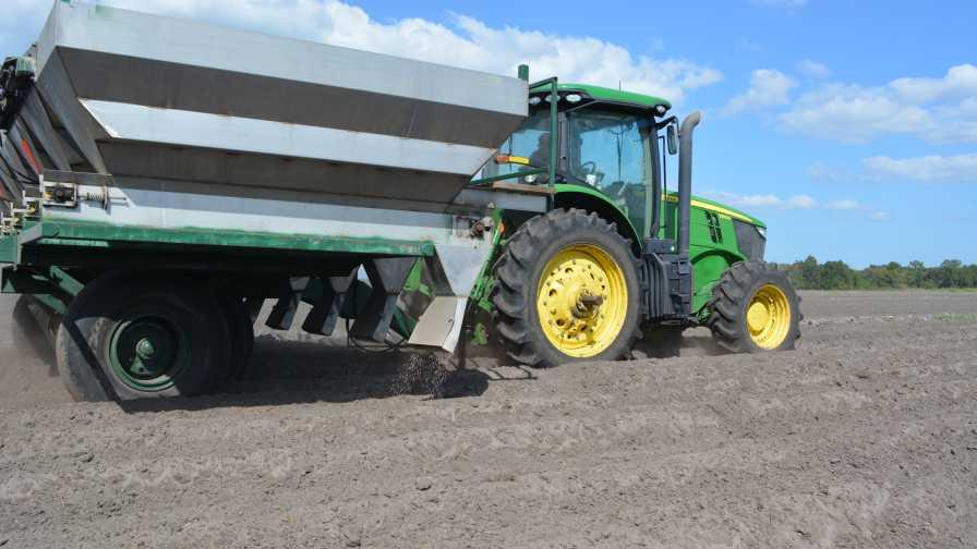 Banding dry fertilizer on a potato field