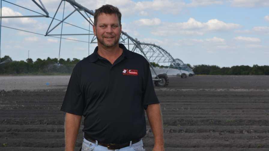 Alan Jones standing in a potato field