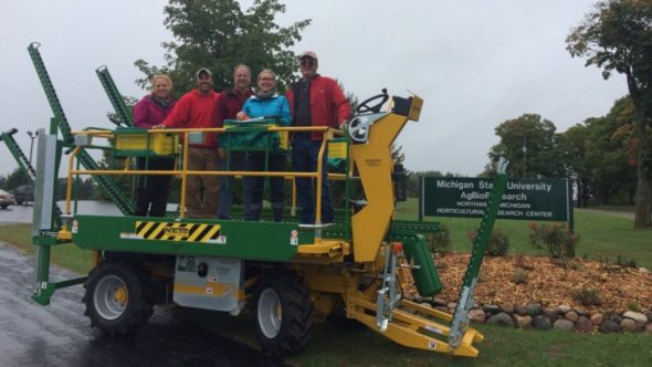 The Northwest Michigan Horticulture Research Center staff and Mark Miezio, a Michigan Tree Fruit Commission board member are pictured with the station's new Blosi platform, purchased with funding from the Michigan Tree Fruit Commission. (Photo credit: Northwest Michigan Horticulture Research Center)