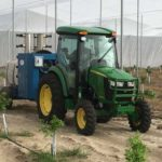 Smaller John Deere tractor for use in citrus screenhouse