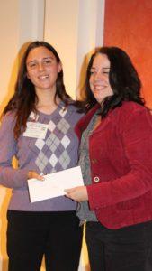 Stephanie Makela of Michigan State University, left, receives a scholarship from Carol Miller, Editor of American Vegetable Grower magazine. (Photo credit: David Eddy)