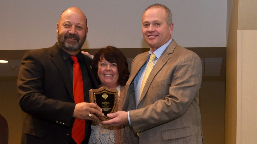Boyd Foster (right) of Vista Valley Ag in Ririe, ID, received the 2016 Environmental Stewardship Award during the National Potato Council's 2017 Annual Meeting, which was held Jan. 6 in San Francisco, CA. Pictured here are Jim Tiede, NPC's 2016 President, and Laurie Foster, Boyd's wife. Photo courtesy of the National Potato Council.