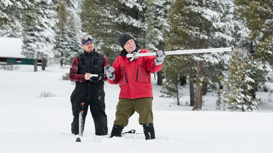 From left, John Paasch (California Department of Water Resources, Chief of Flood Operations), and Frank Gehrke (California Department of Water Resources, Chief of Snow Surveys) conduct a manual snow survey Jan. 3 at Phillips Station, CA, just off Highway 50 near Sierra-at-Tahoe Road approximately 90 miles east of Sacramento. (Photo credit: Florence Low, California Department of Water Resources)