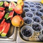 school lunch tray full of Florida-grown blueberries and watermelon