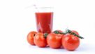 tomato juice glass and tomatoes