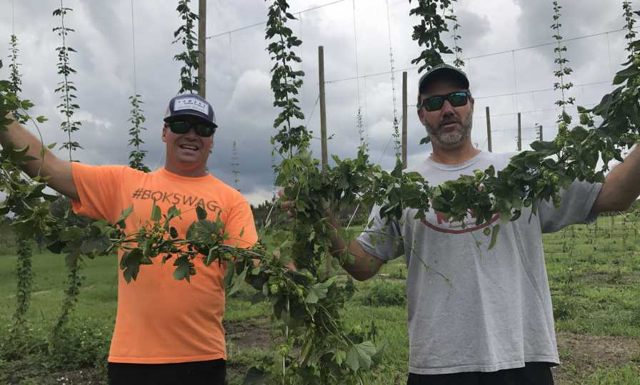 The crew from Caloosa Hop Co. showing off fruits of their labor