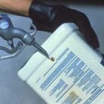 pressure rinsing empty pesticide container