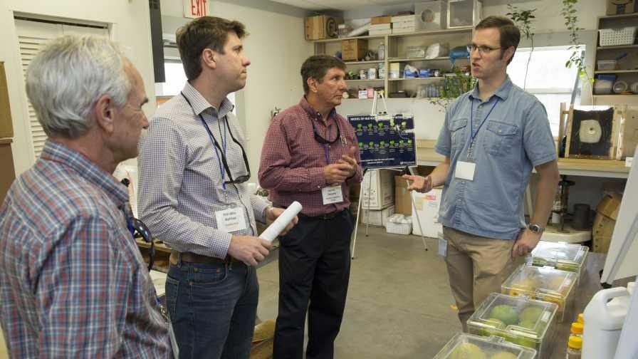 Evan Johnson show his lab work during CREC 100 celebration