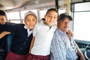 Fair-Trade-bus-driver-and-kids